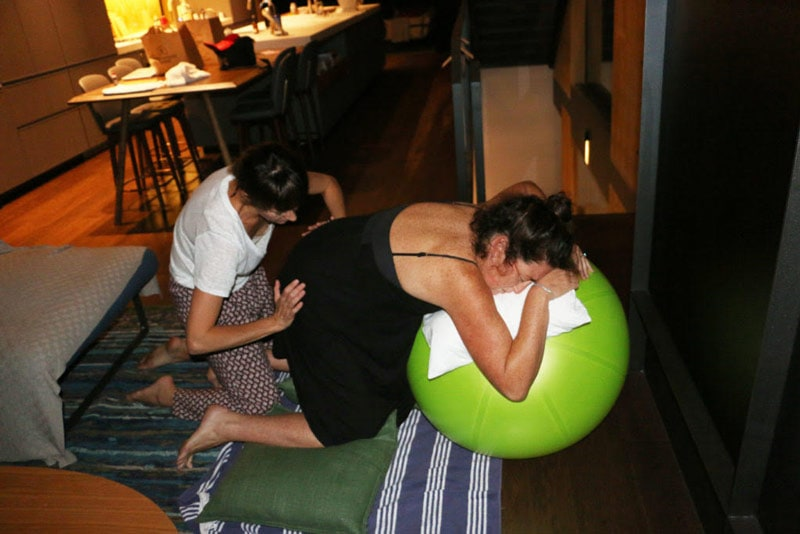 Rachel Campbell having a bilateral hip squeeze while resting on an exercise ball