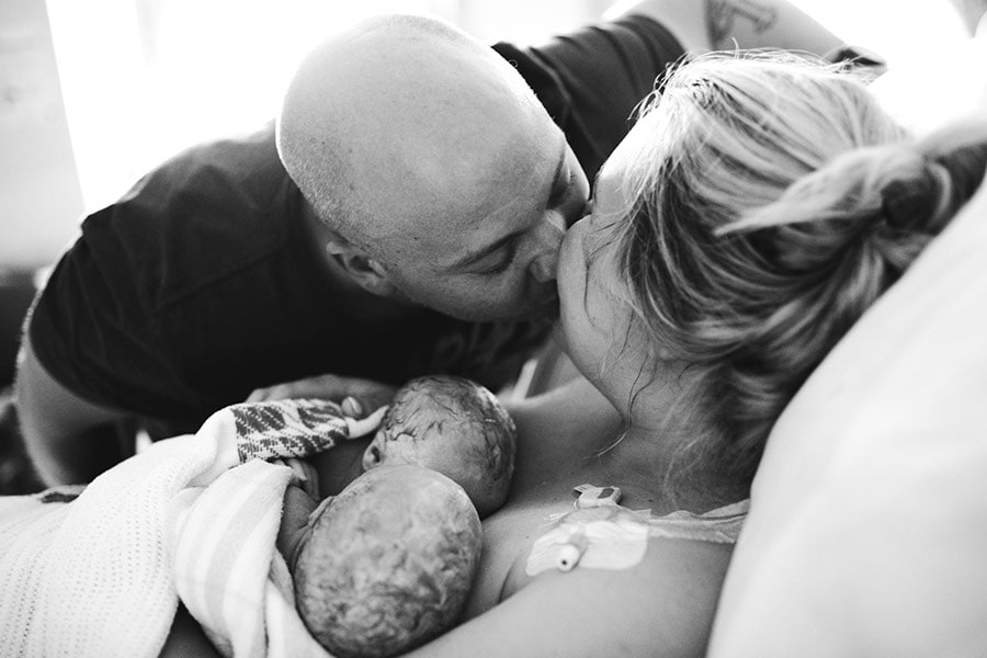 couple with new born twins photo Sarah Pulling of Bear Hunt Photography