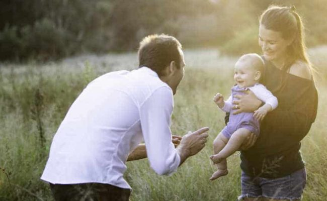family photo in field Daddy doula Story